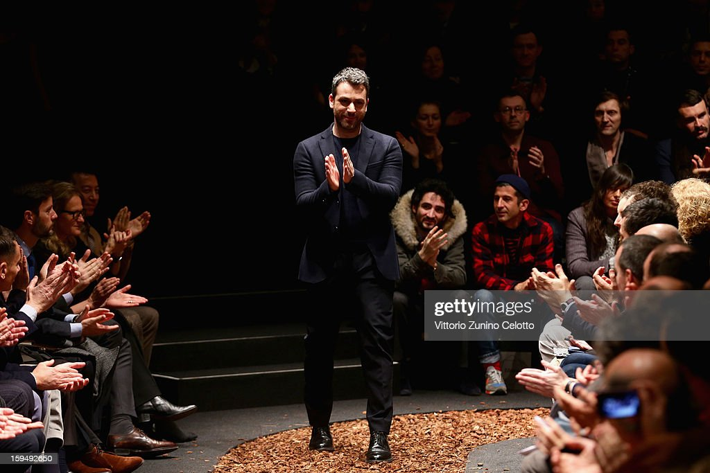 Designer Paul Surridge acknowledges the applause of the audience after the Z Zegna show as part of Milan Fashion Week Menswear Autumn/Winter 2013 on January 14, 2013 in Milan, Italy.