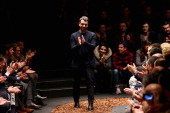 Designer Paul Surridge acknowledges the applause of the audience after the Z Zegna show as part of Milan Fashion Week Menswear Autumn/Winter 2013 on...
