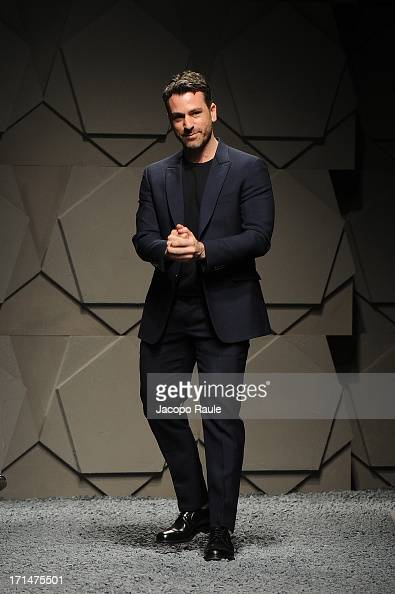 Designer Paul Surridge acknowledges the applause of the audience after the Z Zegna show during Milan Menswear Fashion Week Spring Summer 2014 on June...