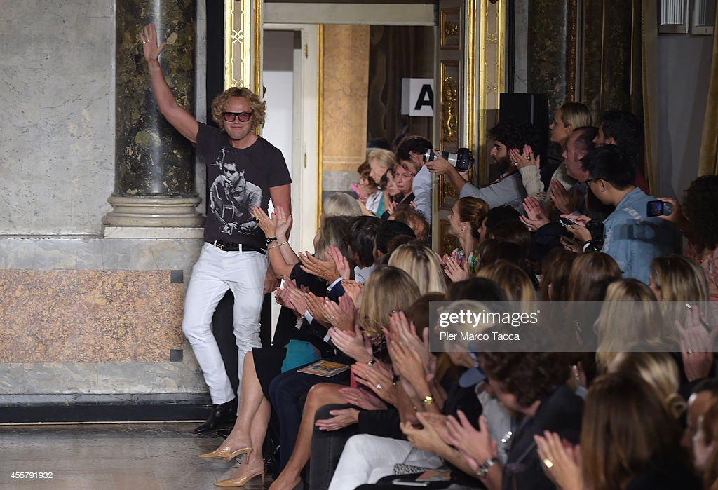 Designer Peter Dundas acknowledges the applause of the public after the Pucci Show as part of Milan Fashion Week Womenswear Spring/Summer 2015 on...