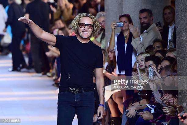 Designer Peter Dundas greets the audience at the end of the show for fashion house Roberto Cavalli during the women Spring / Summer 2016 Milan's...