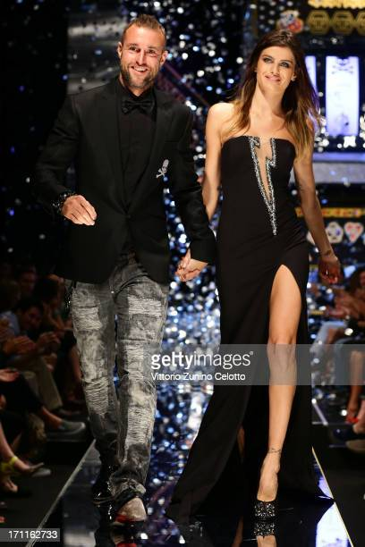 Designer Philip Plein and model Isabeli Fontana after the show on the runway at the Philipp Plein show during Milan Menswear Fashion Week Spring...