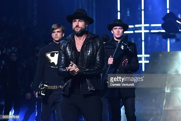 Designer Philipp Plein aknowledge the applause of the public after the Philipp Plein show during Milan Men's Fashion Week Fall/Winter 2016/17 on...