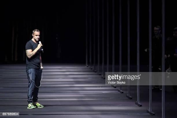 Designer Philipp Plein speaks on the runway at the Billionaire show during Milan Men's Fashion Week Spring/Summer 2018 on June 19 2017 in Milan Italy