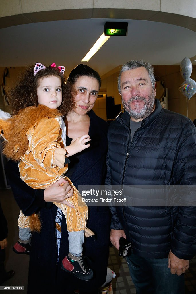Designer <a gi-track='captionPersonalityLinkClicked' href=/galleries/search?phrase=Philippe+Starck&family=editorial&specificpeople=3961802 ng-click='$event.stopPropagation()'>Philippe Starck</a> with his wife Jasmine and their daughter Justice attend the Matinee 'Reve d'enfants' with Ballet 'Casse Noisette'. Organized by AROP at Opera Bastille on December 7, 2014 in Paris, France.