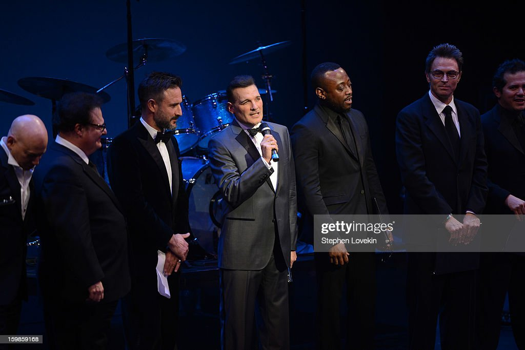Designer Phillip Bloch (C) speaks onstage with Evan Handler, Wayne Knight, David Arquette, Omar Epps, Tim Daly, and John Leguizamo at The Creative Coalition's 2013 Inaugural Ball at the Harman Center for the Arts on January 21, 2013 in Washington, United States.