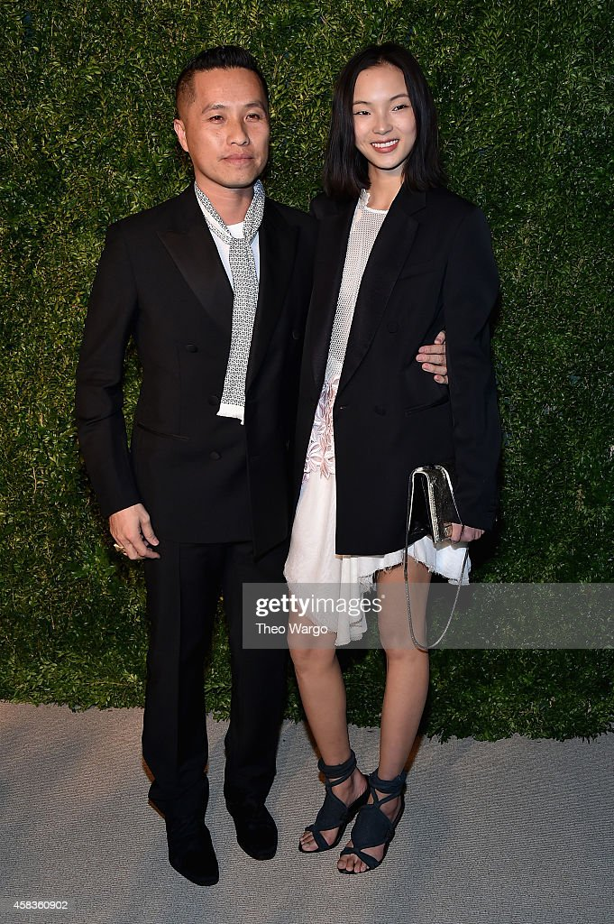 Designer Phillip Lim (L) and model Xiao Wen Ju attend the 11th annual CFDA/Vogue Fashion Fund Awards at Spring Studios on November 3, 2014 in New York City.