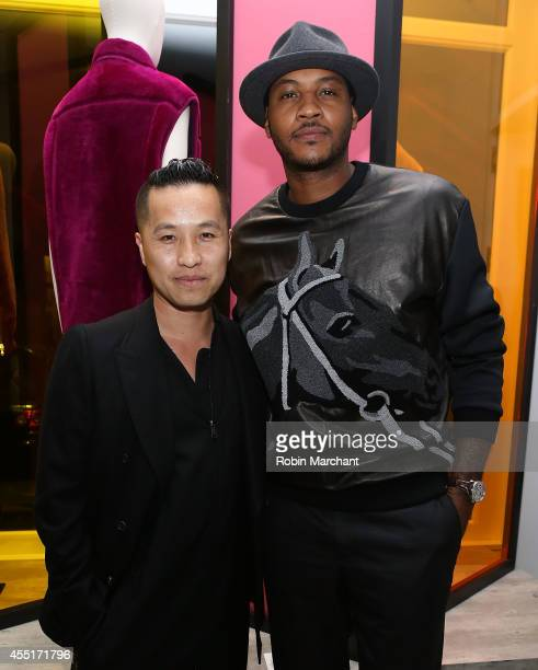 Designer Phillip Lim and NBA player Carmelo Anthony attend 31 Phillip Lim NYC Flagship Store Opening on September 9 2014 in New York City