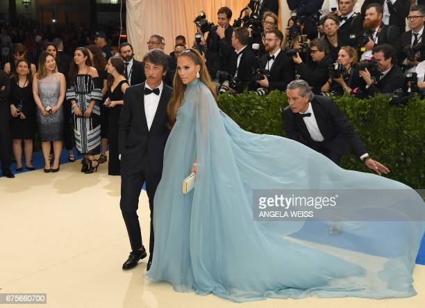 Designer Pierpaolo Piccioli and Jennifer Lopez attend the Costume Institute Benefit May 1 2017 at the Metropolitan Museum of Art in New York / AFP...