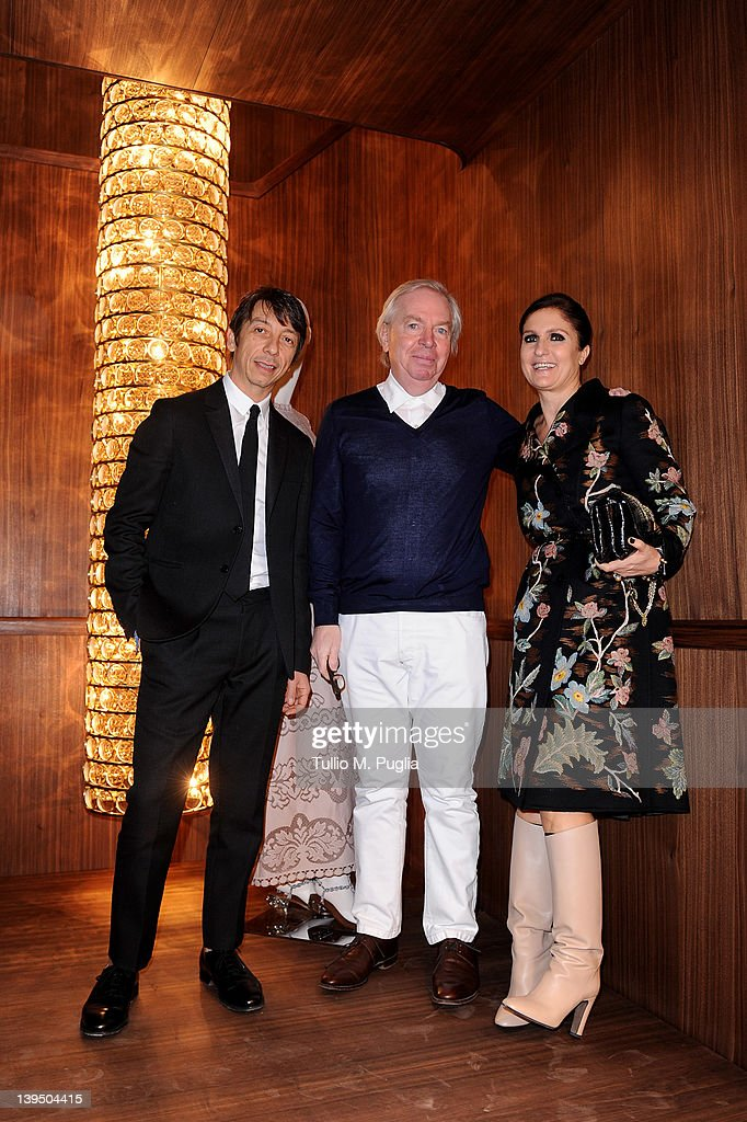 Designer Pierpaolo Piccioli, Architect <a gi-track='captionPersonalityLinkClicked' href=/galleries/search?phrase=David+Chipperfield&family=editorial&specificpeople=2103568 ng-click='$event.stopPropagation()'>David Chipperfield</a> and Designer <a gi-track='captionPersonalityLinkClicked' href=/galleries/search?phrase=Maria+Grazia+Chiuri&family=editorial&specificpeople=5551257 ng-click='$event.stopPropagation()'>Maria Grazia Chiuri</a> pose before a press conference ahead of the Valentino flagship store opening on February 22, 2012 in Milan, Italy.