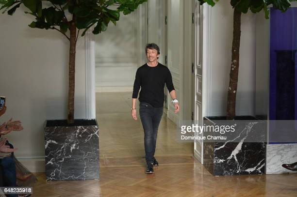 Designer Pierpaolo Piccioli walks the runway during the Valentino show as part of the Paris Fashion Week Womenswear Fall/Winter 2017/2018 on March 5...