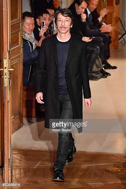Designer Pierpaolo Piccioli walks the runway during the Valentino Menswear Fall/Winter 20172018 show as part of Paris Fashion Week on January 18 2017...