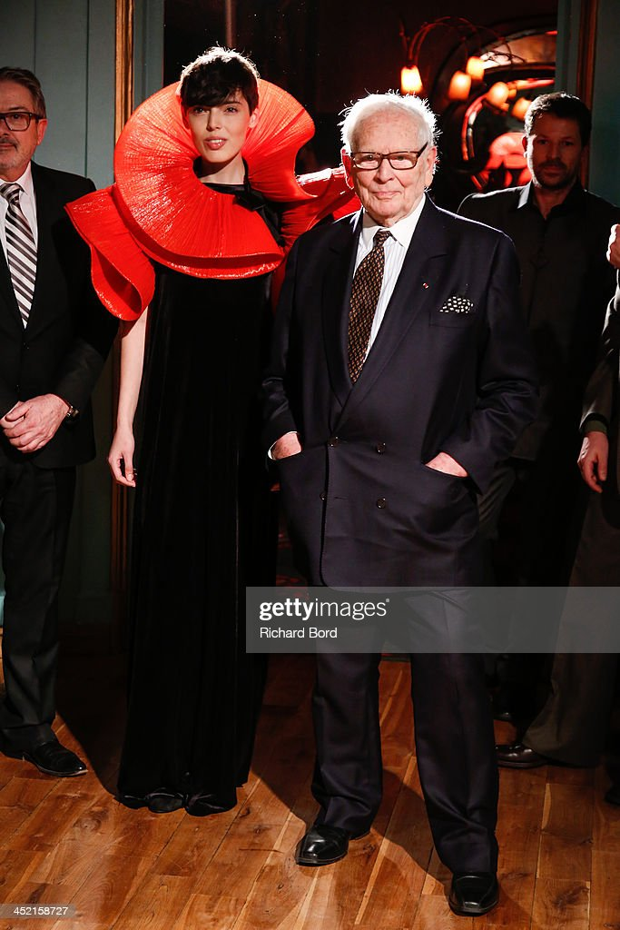 Designer Pierre Cardin and a model pose during the Pierre Cardin Paris Haute Couture New Collection launch at Maxim's on November 26, 2013 in Paris, France.