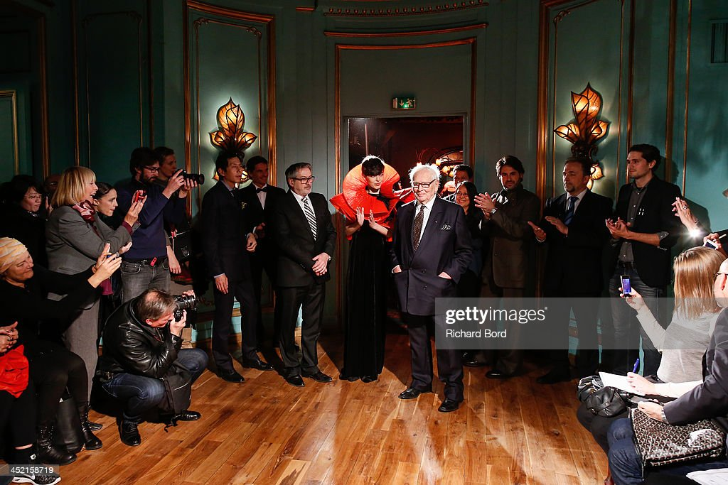 Designer Pierre Cardin (C) pose with a model and his staff during the Pierre Cardin Paris Haute Couture New Collection launch at Maxim's on November 26, 2013 in Paris, France.
