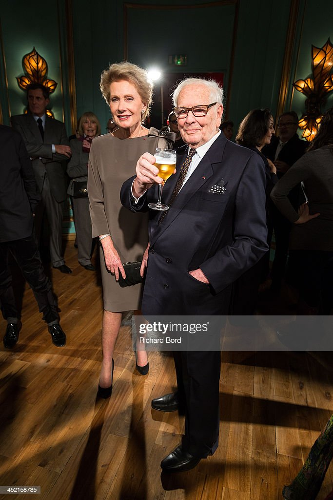 Designer Pierre Cardin poses with Elisa Servier during the Pierre Cardin Paris Haute Couture New Collection launch at Maxim's on November 26, 2013 in Paris, France.