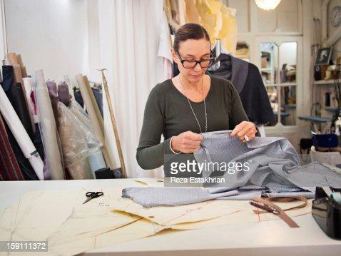 Designer places together garment panels : Stock Photo