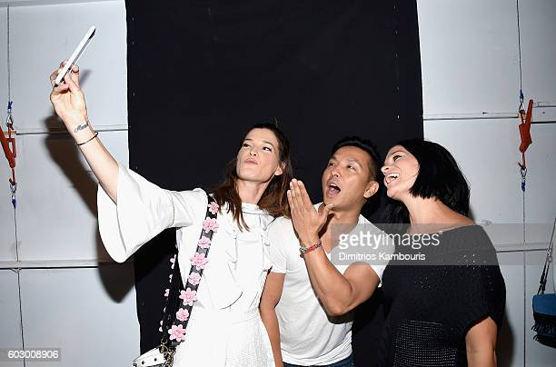 Designer Prabal Gurung poses with Leigh Lezark and guest backstage at the Prabal Gurung fashion show during New York Fashion Week The Shows September...