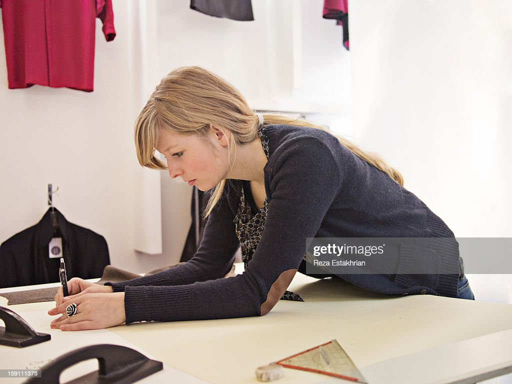 Designer prepares garment pattern : Stock Photo