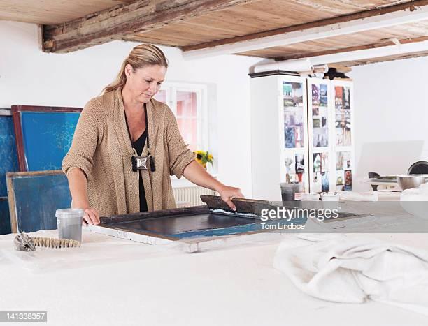 Designer printing on textiles in studio