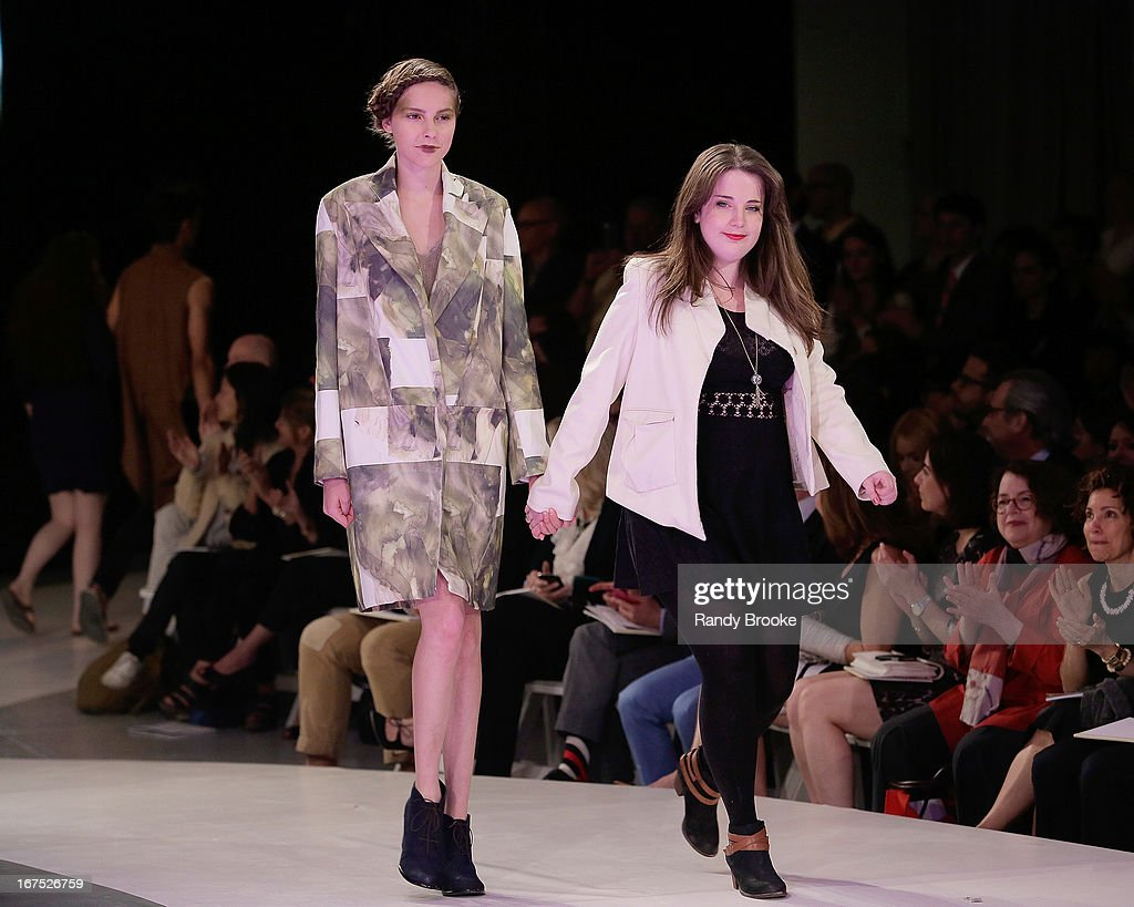 Designer Rachel Duncan (r) walks the runway with a model wearing one of her designs at the 114th Annual Pratt Institute Fashion Show at Center 548 on April 25, 2013 in New York City.