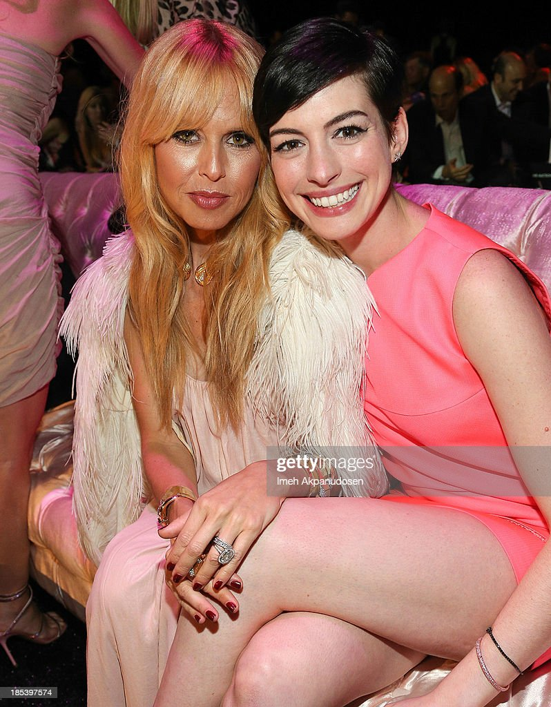 Designer Rachel Zoe (L) and actress <a gi-track='captionPersonalityLinkClicked' href=/galleries/search?phrase=Anne+Hathaway+-+Actress&family=editorial&specificpeople=11647173 ng-click='$event.stopPropagation()'>Anne Hathaway</a> attend FIJI Water at the 9th Annual Pink Party Benefiting The Cedars-Sinai Women's Cancer Program at