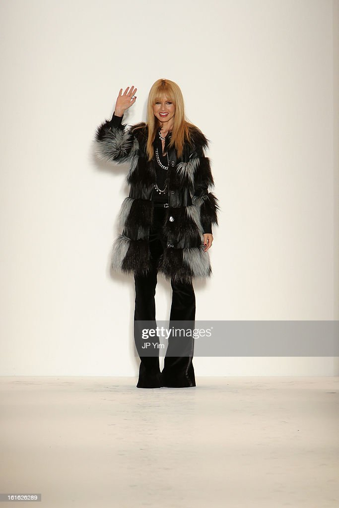 Designer Rachel Zoe waves to the audience at the Rachel Zoe Fall 2013 fashion show during Mercedes-Benz Fashion Week in The Studio at Lincoln Center on February 13, 2013 in New York City.