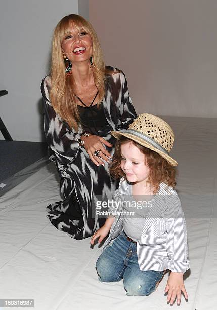 Designer Rachel Zoe with son Skyler Berman attend the Rachel Zoe show during Spring 2014 MercedesBenz Fashion Week at The Studio at Lincoln Center on...