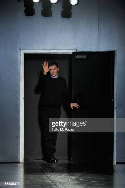 Designer Raf Simons acknowledges the applause of the audience after the Jil Sander fashion show as part of Milan Fashion Week Menswear Autumn/Winter...