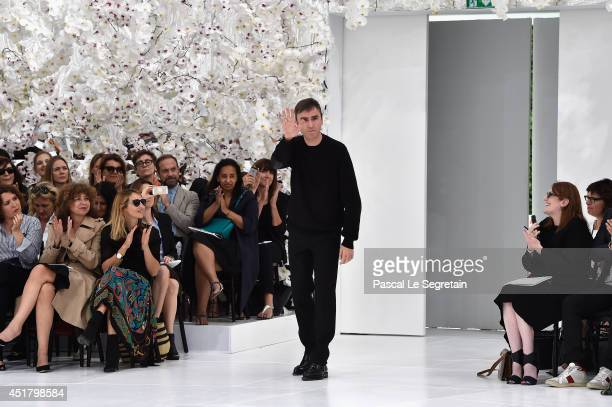 Designer Raf Simons acknowledges the applause of the audience after the Christian Dior show as part of Paris Fashion Week Haute Couture Fall/Winter...