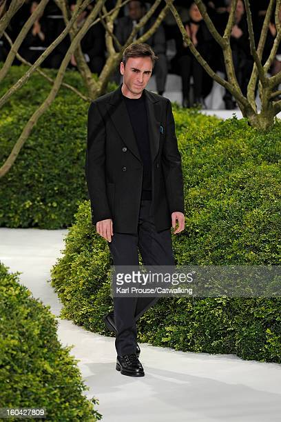 Designer Raf Simons walks the runway at the Christian Dior Spring Summer 2013 fashion show during Paris Haute Couture Fashion Week on January 21 2013...