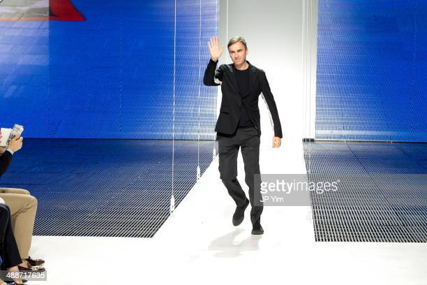 Designer Raf Simons walks the runway at the conclusion of the Christian Dior Cruise 2015 show at Brooklyn Navy Yard on May 7 2014 in the Brooklyn...