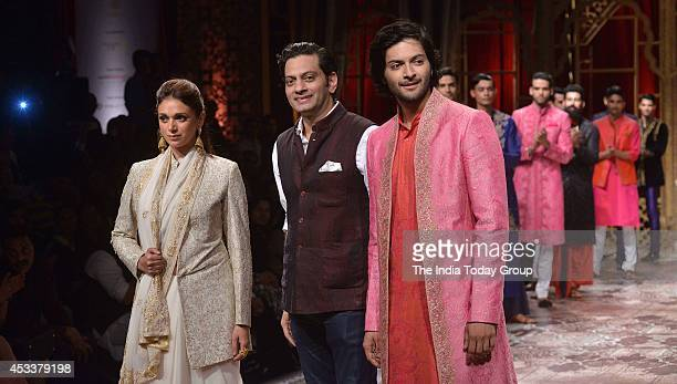 Designer Raghuvendra Rathore with actress Aditi Rao Hydari and Ali Fazal at BMW India Bridal Fashion Week 2014