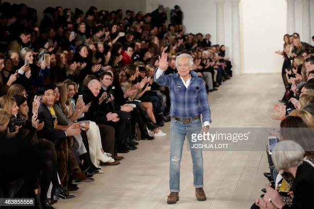 Designer Ralph Lauren acknowledges his guest as he waves after showing his Fall/Winter runway collection during the New York Fashion Week on February...