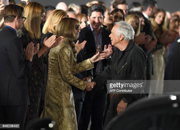 Designer Ralph Lauren greets Anna Wintour editor in chief of Vogue during his Ralph Lauren Collection 2017 show in his garage in Bedford New York on...