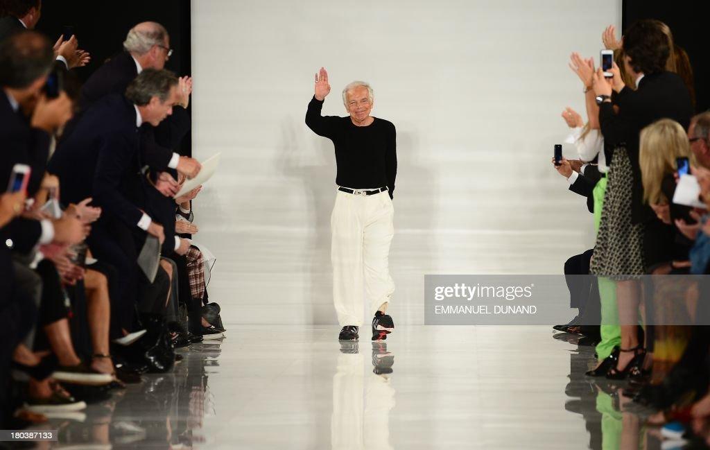 Designer Ralph Lauren greets spectators during the Mercedes-Benz Fashion Week Spring 2014 collection in New York on September 12, 2013. AFP PHOTO/Emmanuel Dunand