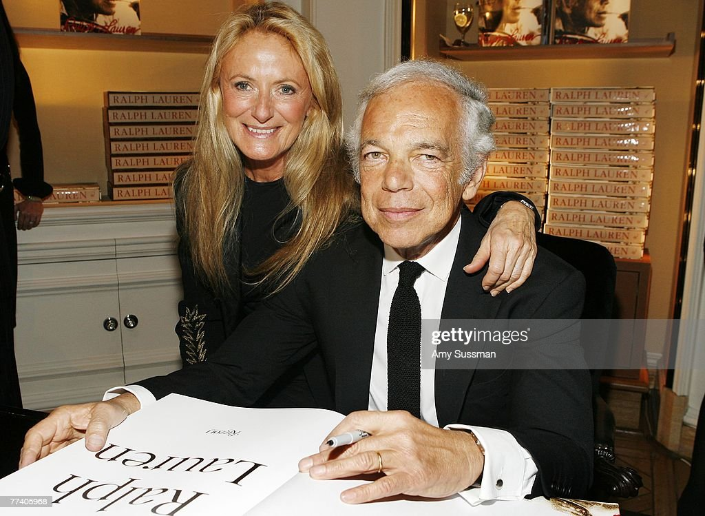 Designer Ralph Lauren (R) signing his book with his wife Ricky Lauren (L