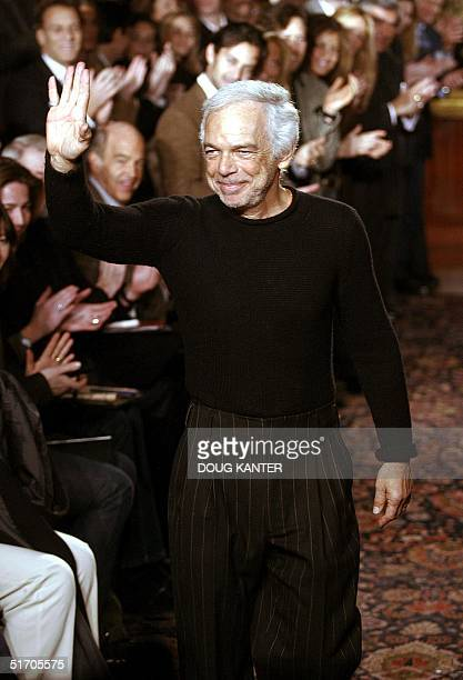 Designer Ralph Lauren waves to the crowd at the conclusion of his Fall 2002 fashion show in New York 14 February 2002 AFP PHOTO/Doug KANTER