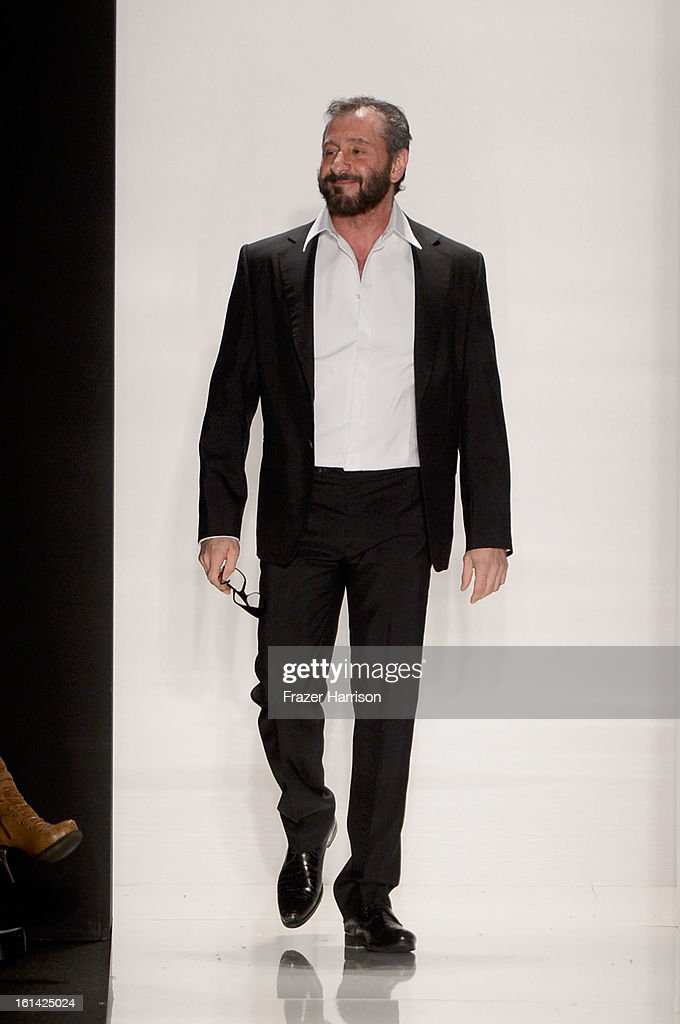 Designer <a gi-track='captionPersonalityLinkClicked' href=/galleries/search?phrase=Ralph+Rucci+-+Fashion+Designer&family=editorial&specificpeople=12460286 ng-click='$event.stopPropagation()'>Ralph Rucci</a> walks the runway at the <a gi-track='captionPersonalityLinkClicked' href=/galleries/search?phrase=Ralph+Rucci+-+Fashion+Designer&family=editorial&specificpeople=12460286 ng-click='$event.stopPropagation()'>Ralph Rucci</a> Fall 2013 fashion show during Mercedes-Benz Fashion Week at at Lincoln Center on February 10, 2013 in New York City.