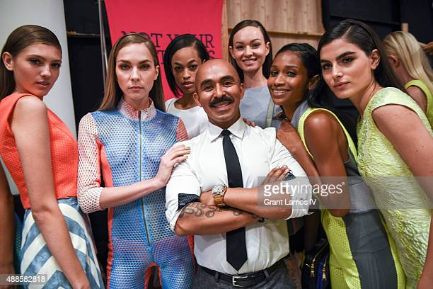 Designer Raul Penaranda poses with models backstage at his show at Metropolitan West on September 16 2015 in New York City