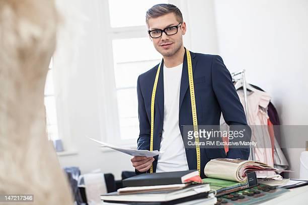 Designer reading notes in studio