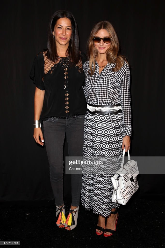 Designer Rebecca Minkoff (L) and Olivia Palermo pose backstage at the Rebecca Minkoff Spring 2014 fashion show during Mercedes-Benz Fashion Week at The Theatre at Lincoln Center on September 6, 2013 in New York City.