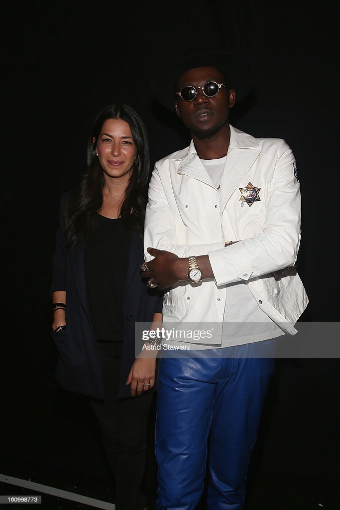 Designer Rebecca Minkoff and rapper <a gi-track='captionPersonalityLinkClicked' href=/galleries/search?phrase=Theophilus+London&family=editorial&specificpeople=5770992 ng-click='$event.stopPropagation()'>Theophilus London</a> pose backstage at the TRESemme At Rebecca Minkoff Fall 2013 fashion show during Mercedes-Benz Fashion Week at The Theatre at Lincoln Center on February 8, 2013 in New York City.
