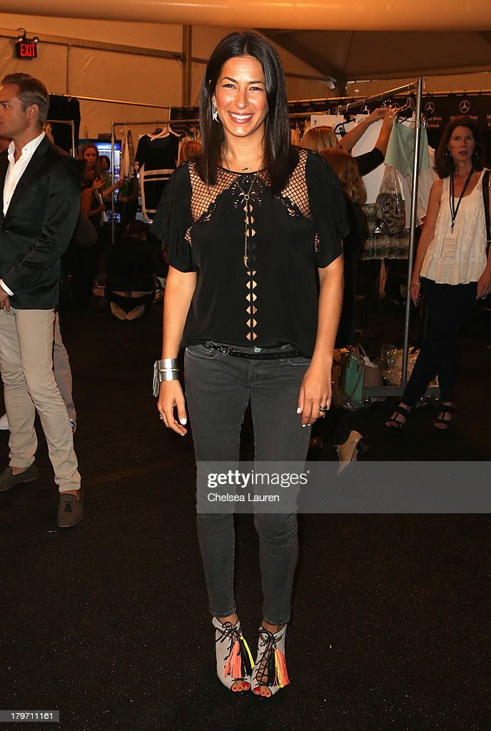 Designer Rebecca Minkoff poses backstage at the Rebecca Minkoff Spring 2014 fashion show during Mercedes-Benz Fashion Week at The Theatre at Lincoln Center on September 6, 2013 in New York City.