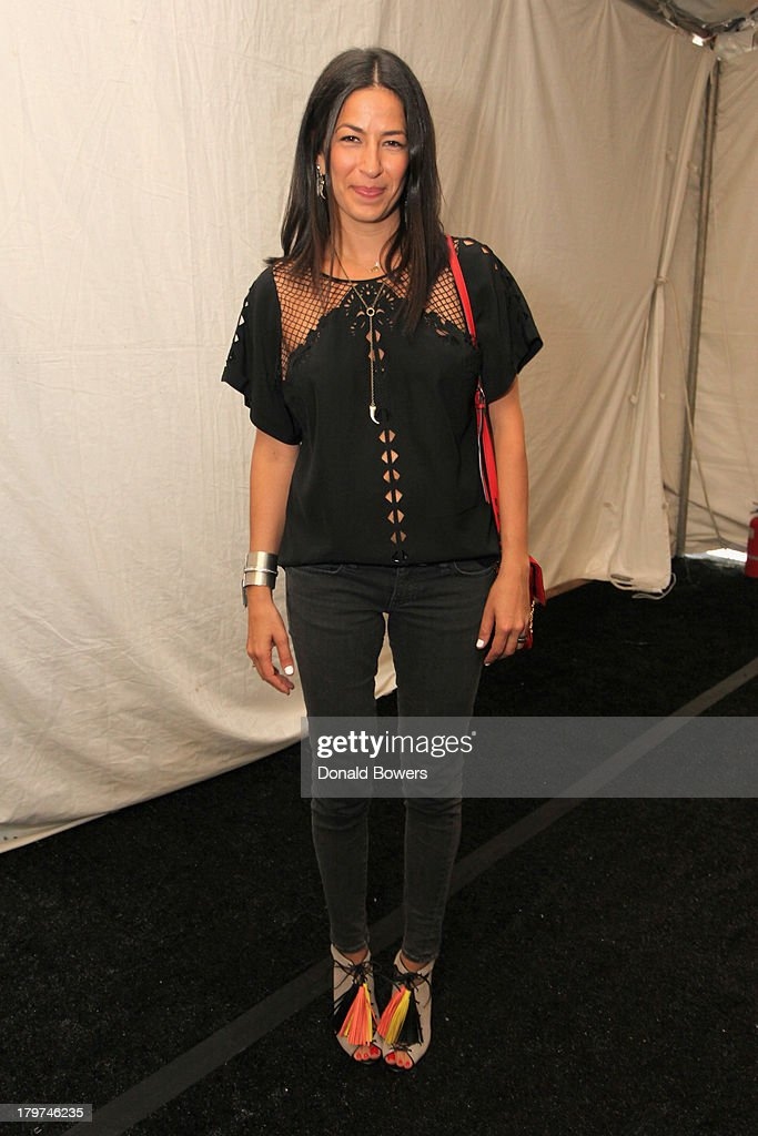 Designer Rebecca Minkoff poses outside the Samsung Galaxy Blue Room at Mercedes-Benz Fashion Week Spring 2014 Collections at Lincoln Center on September 6, 2013 in New York City.