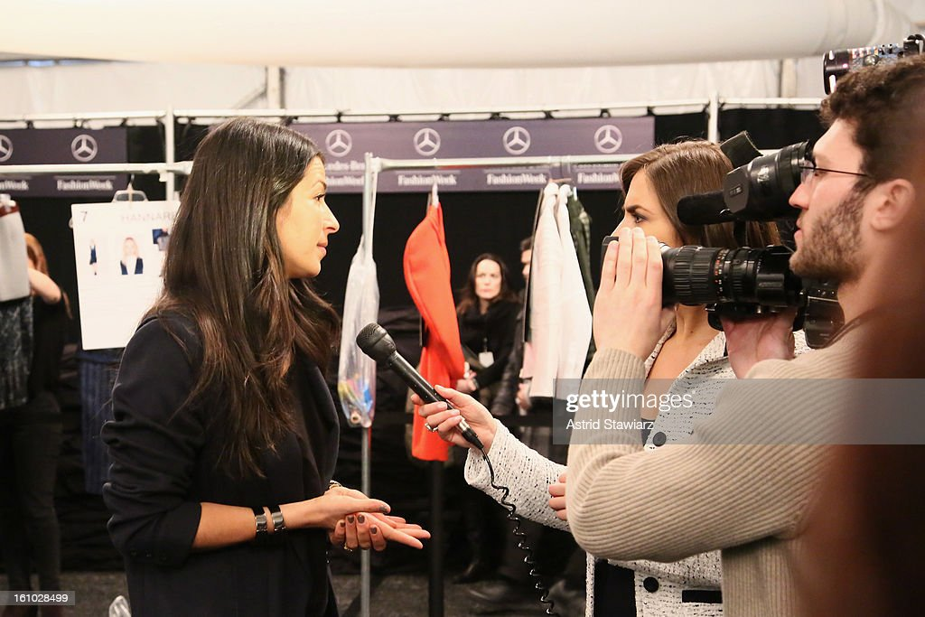 Designer Rebecca Minkoff prepares backstage at the TRESemme At Rebecca Minkoff Fall 2013 fashion show during Mercedes-Benz Fashion Week at The Theatre at Lincoln Center on February 8, 2013 in New York City.