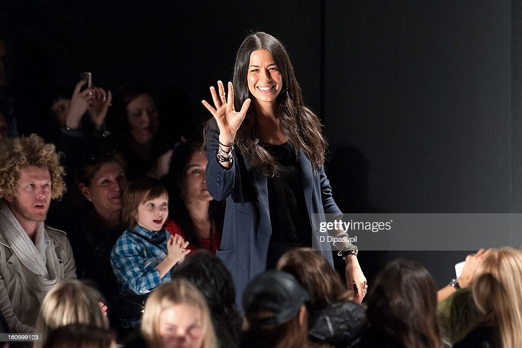 Designer Rebecca Minkoff waves to the audience after the Rebecca Minkoff Fall 2013 Mercedes-Benz Fashion Show at The Theater at Lincoln Center on February 8, 2013 in New York City.