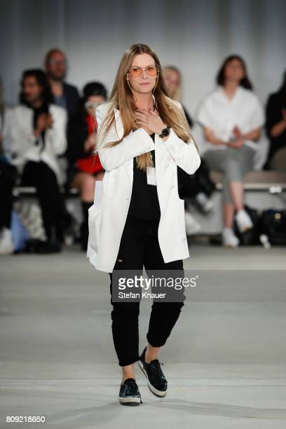 Designer Rebekka Ruetz acknowledges the applause of the audience at the Rebekka Ruetz show during the MercedesBenz Fashion Week Berlin Spring/Summer...
