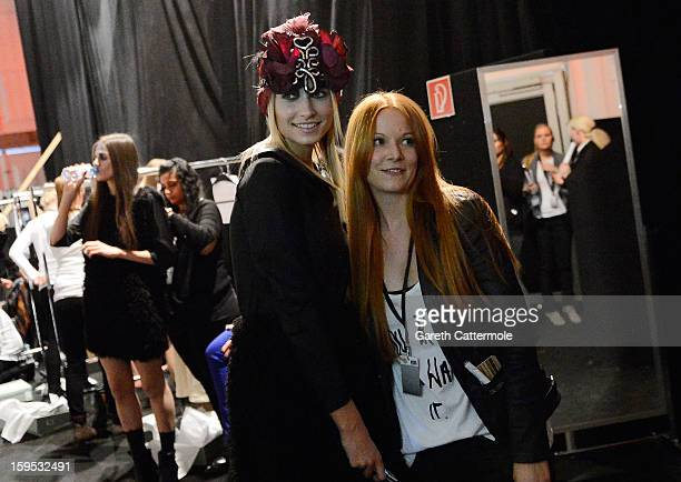 Designer Rebekka Ruetz poses with a model during the Rebekka Ruetz Autumn/Winter 2013/14 fashion show during MercedesBenz Fashion Week Berlin at...