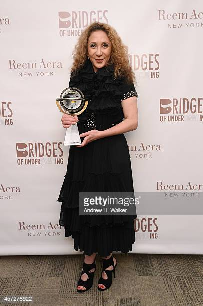 Designer Reem Acra attends Bridges Of Understanding's annual 'Building Bridges' award dinner honoring designer Reem Acra with Steven Kolb on October...