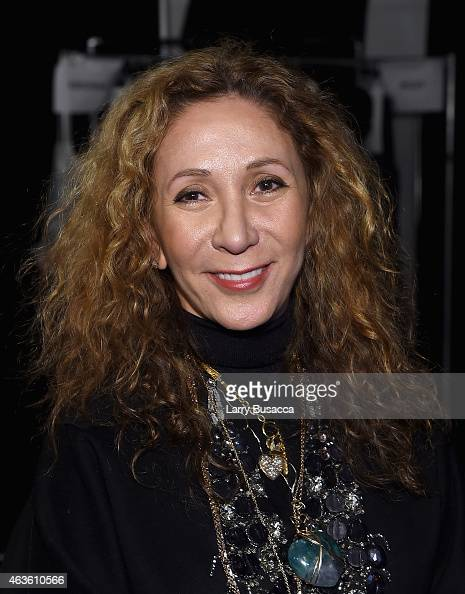 Designer Reem Acra prepares backstage at the Reem Acra fashion show during MercedesBenz Fashion Week Fall 2015 at The Salon at Lincoln Center on...
